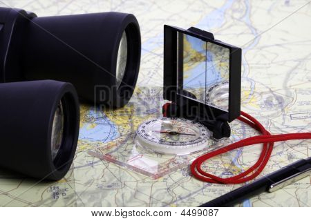 Map,  Binoculars And Compas