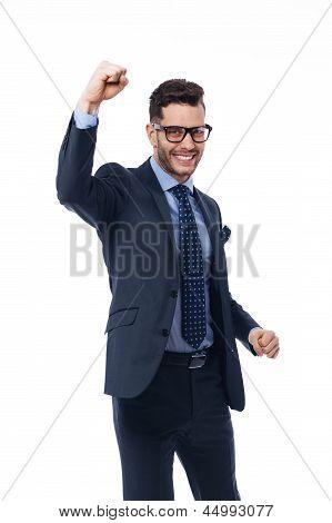 Young businessman enjoys the winning