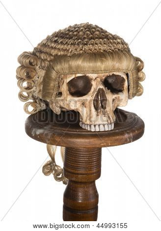 Genuine court wig isolated on a creepy skull