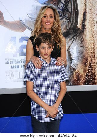 LOS ANGELES - APR 09:  Kim Raver & son Luke arrives to the '42' Hollywood Premiere  on April 09, 2013 in Hollywood, CA