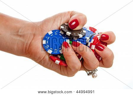 Hand Holding Poker Chips
