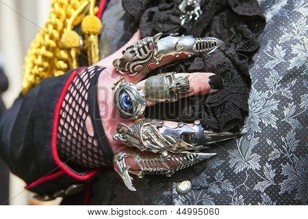 Man's hand with many rings.