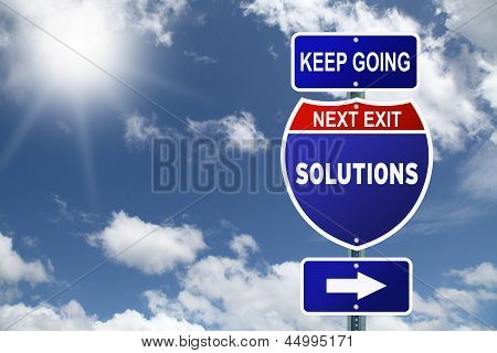 Keep going next exit solutions road sign