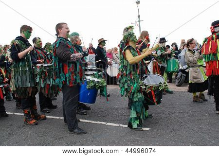 HASTINGS, ENGLAND - MAY 7: Drummers perform during a parade on the West Hill at the annual, May Day, Jack In The Green festival on May 7, 2012 in Hastings, East Sussex.