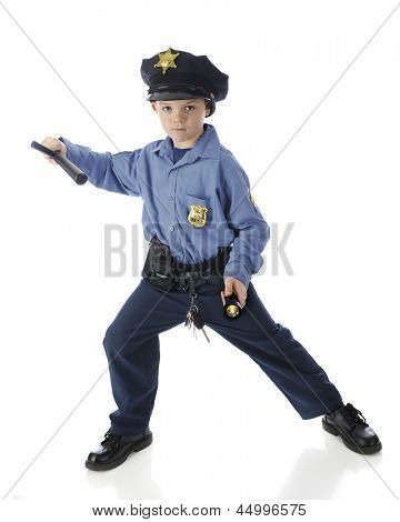 """A serious elementary """"policeman"""" in a protective stance, a flashlight in one hand, his nightstick in the other.  On a white background."""