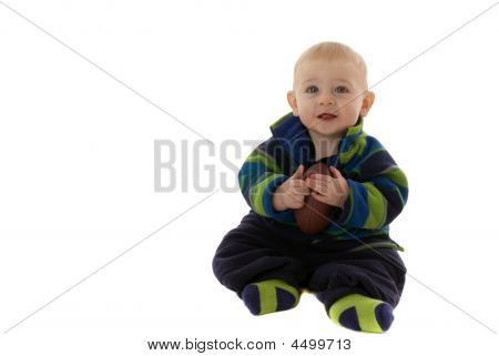 Happy Baby Boy Holds Football While Smiling
