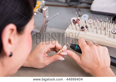 Technician At Work In A Dental Lab Or Workshop Producing A Prostheis