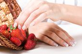 picture of french manicure  - Beautiful hands with French manicure and fresh strawberry - JPG