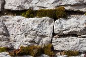 Old Stone Wall With Moss And Lichen