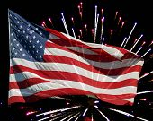 picture of waving american flag  - American flag flying over bursting colorful fireworks - JPG