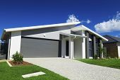 picture of suburban city  - New suburban Australian house with small SOLD sign - JPG