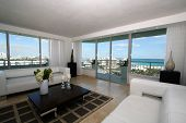 pic of interior decorator  - A living room interior in a luxury home with a view of South Beach - JPG