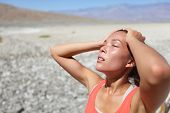 Desert woman thirsty dehydrated in Death Valley. Dehydration, overheating, thirst and heat stroke co