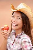 stock photo of cowgirl  - Peach eating cowgirl happy - JPG