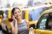 picture of cabs  - Business woman on smart phone in New York City - JPG