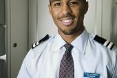 picture of flight attendant  - Close up portrait of male flight attendant - JPG