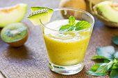 stock photo of honeydew melon  - Melon with Kiwi and Mango smoothie in glasses