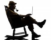 stock photo of sherlock holmes  - sherlock holmes with computer laptop silhouette sitting in rocking chair in studio on white background - JPG