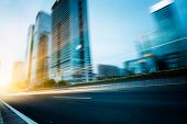 stock photo of speeding car  - the light trails on the modern building background in shanghai china - JPG