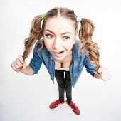 Cute Funny Girl With Two Pony Tails - Wide Angle Shot
