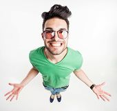 picture of shot glasses  - funny handsome man with hipster glasses showing his palms and smiling large  - JPG