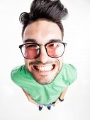 pic of shot glasses  - funny handsome man with hipster glasses smiling  - JPG