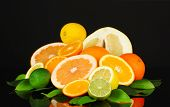 image of pamelo  - Lots ripe citrus isolated on black - JPG