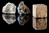 Chalcopyrite and pyrite in uncut rough state, two minerals often confused with gold.  Pyrite is ther