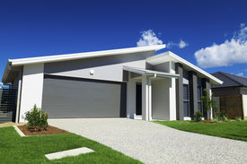 pic of suburban city  - New suburban Australian house with small SOLD sign - JPG