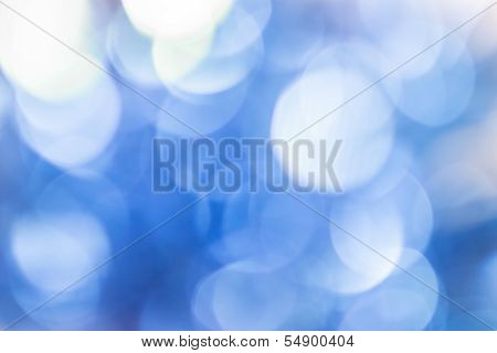 Natural white bokeh on blue background