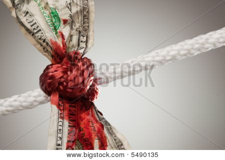 Wrinkled American Dollar Bleeding In Rope