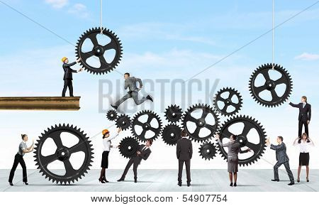 Conceptual image of businessteam working cohesively. Interaction and unity