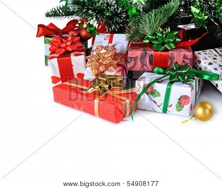 gift boxes  under decorated Christmas tree on white background