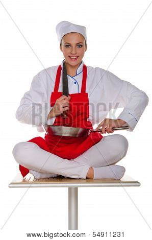Smiling Cook With Dishes