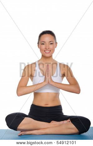 Asian Sitting In The Lotus Position And Smiling