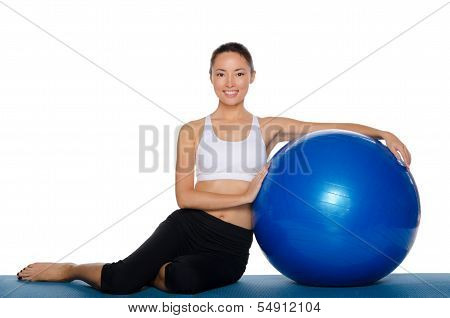 Asian Sits With Blue Ball