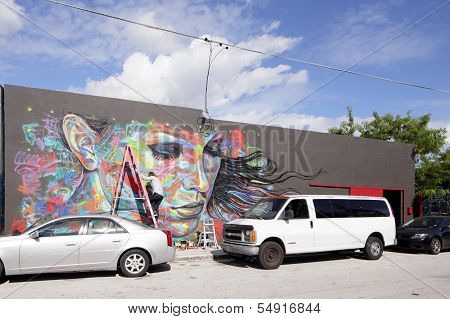Stock image of an artist painting a mural