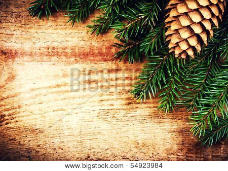 Tree Branch On Wooden Background With Forest Cone And Copy Space For Greeting Text. Christmas Orname