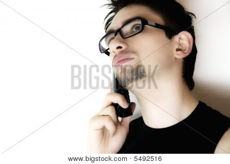 The Thoughtful Young Man Speaking On The Phone