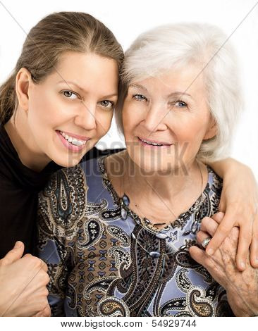 Happy senior woman portrait together with granddaughter