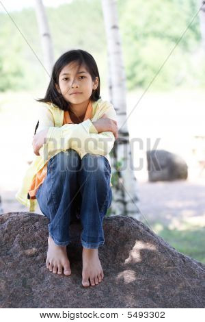 Quiet Child Sitting Under Trees