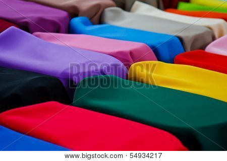 image of Colorful Textile BackgroundPile of bright folded clothes.