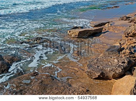 Rocks And Blue Water