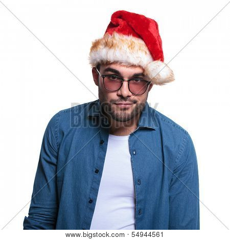 undecided young man in santa hat is looking at the camera on white background