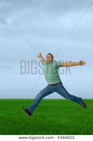 Running Young Happy Man In The Meadow