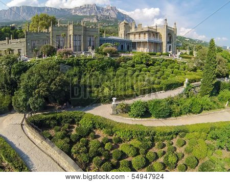 YALTA - AUG 27: Green garden in front of Vorontsov Palace, against the sky and mountain Ay Petri on August 27, 2013 in Yalta, Ukraine. View from unmanned quadrocopter.