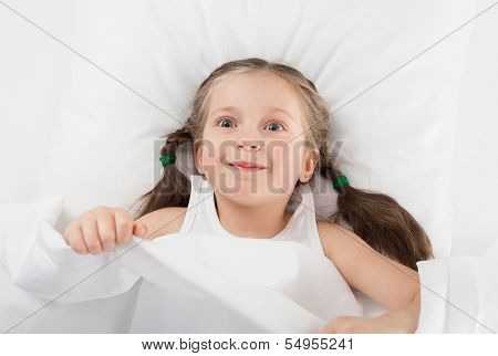 cheerful girl in white bed