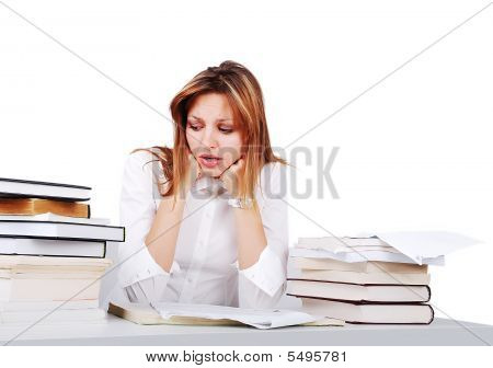 Worried Girl Between Lot Of Books