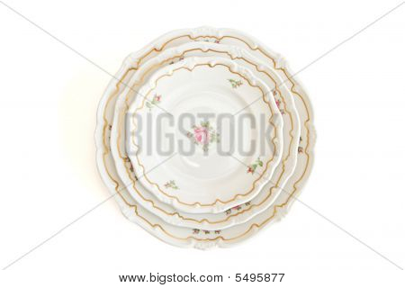Stack Of Three White  Plates And Saucers Top View Isolated