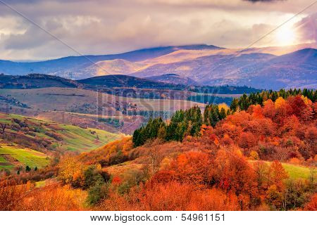 Autumn Hillside With Colorful Foliage Trees Near Valley
